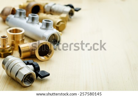 tools plumbing on a light woody background. tinting. selective focus - stock photo