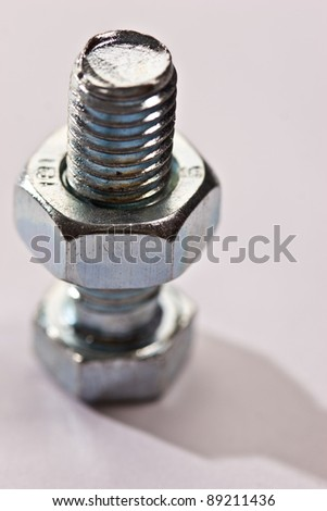 tools series: close up of steel bolt and screw-nut