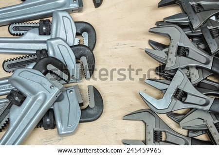 Tools set in vintage picture style . set of hand tools on a wooden background, Wrench tools or Pipe wrench for hard work. - stock photo