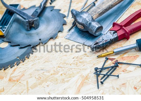 Tools set on osb panel with copy space.  Carpenter workplace on wooden background. Top view. Toned
