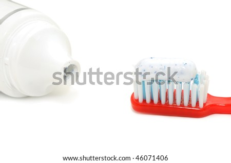 tooth brush and tooth paste isolated on a white background - stock photo