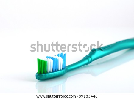 Tooth-brush over white. Shallow DOF. - stock photo