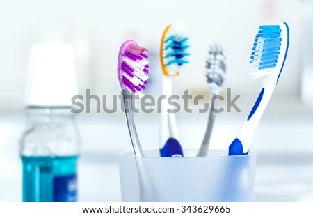 Tooth brushes in glass - stock photo