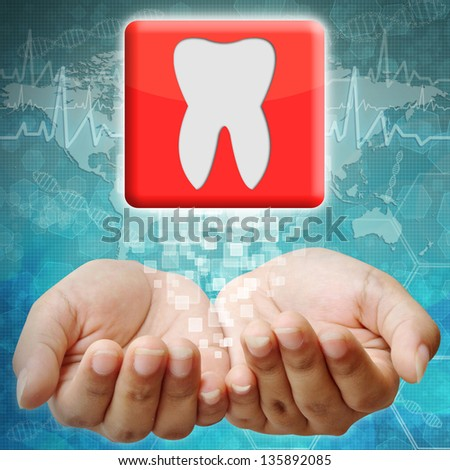 Tooth icon on hand ,medical background - stock photo
