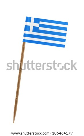 Tooth pick wit a small paper flag of Greece - stock photo
