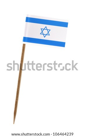 Tooth pick wit a small paper flag of Israel - stock photo