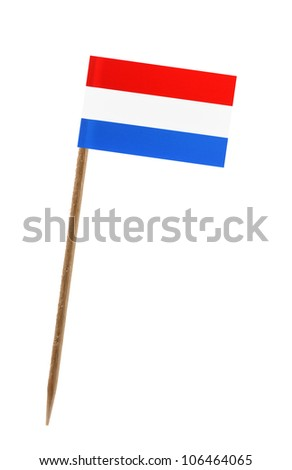 Tooth pick wit a small paper flag of Netherlands - stock photo