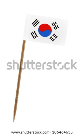 Tooth pick wit a small paper flag of South Korea - stock photo