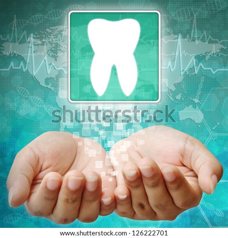 Tooth Symbol on hand,medical background - stock photo