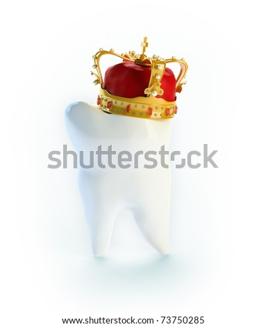 Tooth with a crown - dental care concept - stock photo