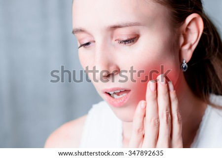 Toothache, dental pain. Health problem, illness. Tooth ache. Young or adult person, people. Painful mouthe. Facial expression. Medical, medicine sickness. One face, portrait. - stock photo
