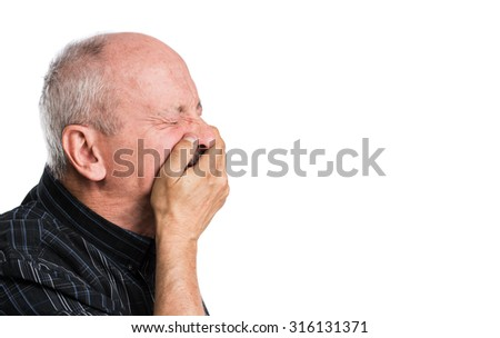 Toothache. Elderly man with face closed by hand on a white background with copy-space - stock photo