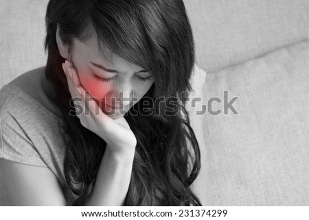 toothache, negative emotion expression - stock photo