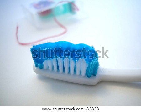 toothbrush and floss...selective focus on floss - stock photo