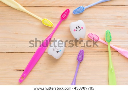toothbrush and tooth,  dental - stock photo