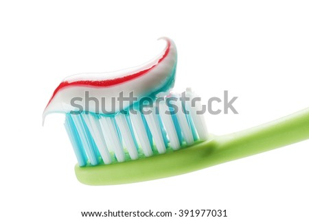Toothbrush and toothpaste isolated on white close up. - stock photo