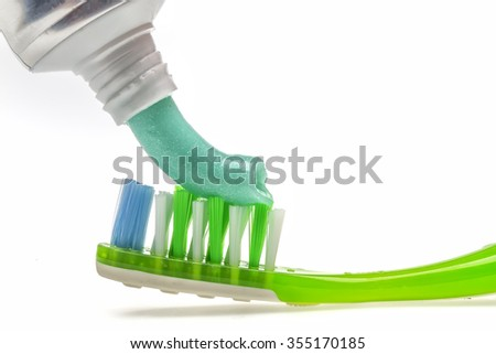 Toothbrush and Toothpaste on a white background