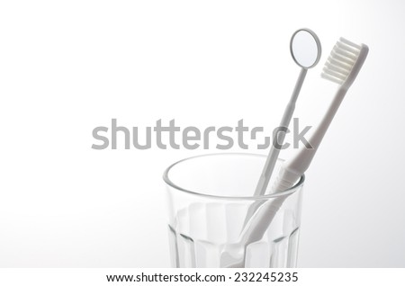 toothbrush in the glass - stock photo