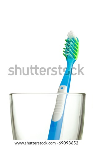 toothbrush in the glass isolated