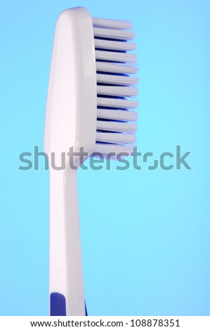 Toothbrush on Blue Background - stock photo