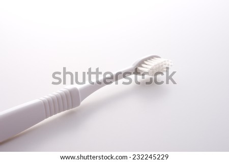 toothbrush on white background - stock photo
