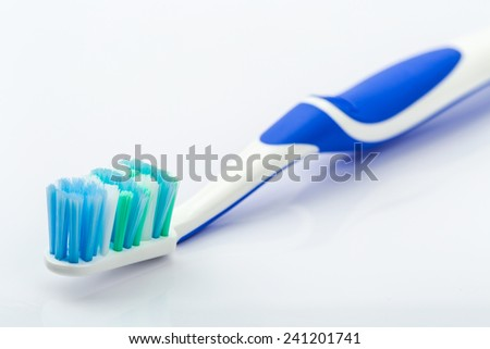 Toothbrush on white background with reflection