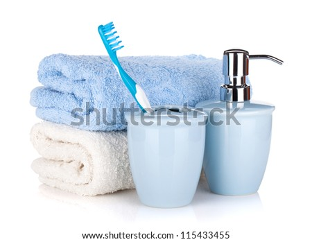 Toothbrush, soap and two towels. Isolated on white background