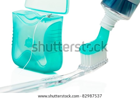 Toothbrush, toothpaste and dental floss isolated on the white background. - stock photo