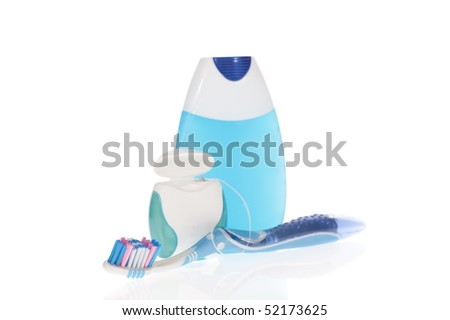Toothbrush, toothpaste and dental floss  isolated on white background - stock photo