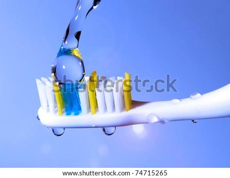toothbrush under the running water - stock photo