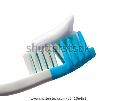 Toothbrush with toothpaste. Isolated on white background. Close-up view. - stock photo