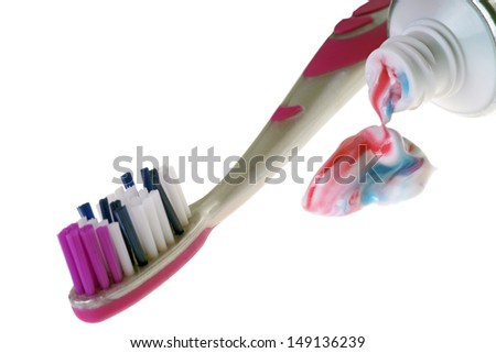 Toothbrush with toothpaste isolated over a white background / dental hygiene - stock photo