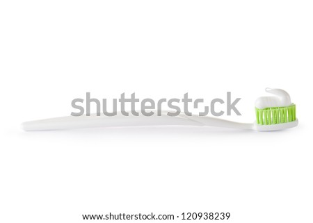 Toothbrush with toothpaste ready for use. Isolated on a white. - stock photo