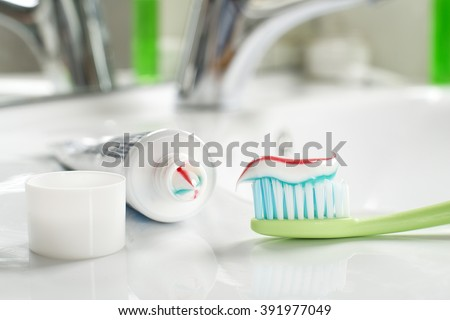 Toothbrushe and toothpaste in the bathroom close up.