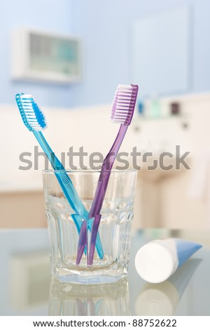 Toothbrushes and toothpaste - stock photo