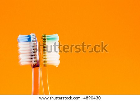 Toothbrushes facing opposite directions. - stock photo