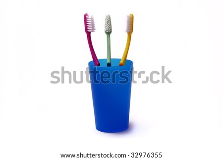 Toothbrushes in a color holder - stock photo