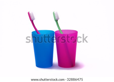 Toothbrushes in color holder - stock photo