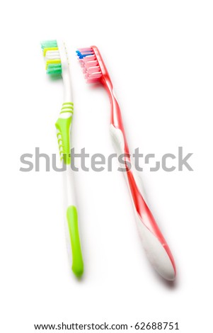 Toothbrushes isolated on white - stock photo
