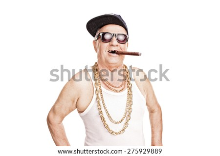 Toothless senior with a hip-hop cap and a gold chain around his neck smoking a cigar isolated on white background - stock photo