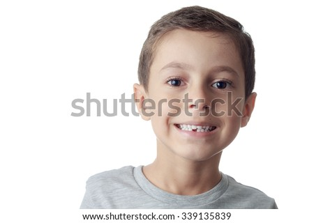 toothless smiling boy showing his lost tooth milk - stock photo