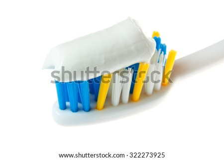 Toothpaste on the brush.