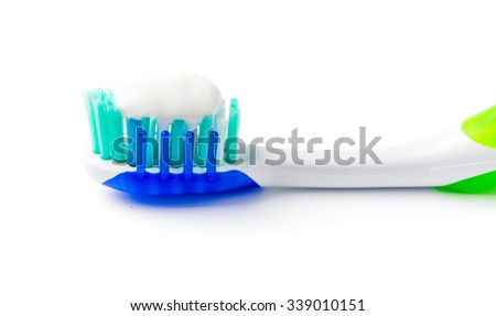 toothpaste on toothbrush isolated on white