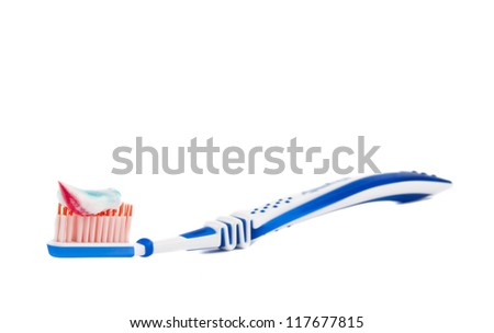 toothpaste with toothbrush isolated on white background