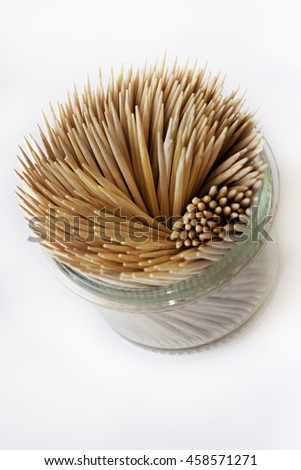 Toothpick in a glass on a white background - stock photo