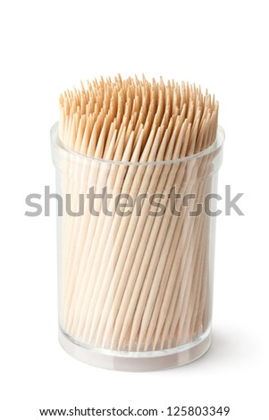 Toothpicks in transparent plastic box. Isolated on a white. - stock photo