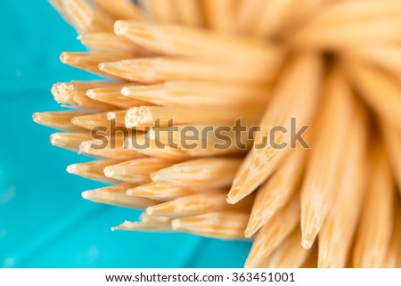toothpicks on a blue background. macro