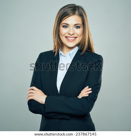 Toothy smiling Business woman crossed arms isolated portrait. Studio isolated - stock photo