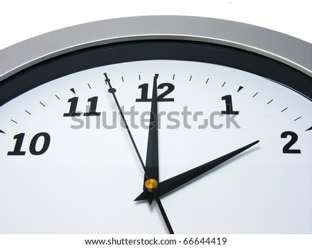 Top area of a wall clock showing 2 am pm