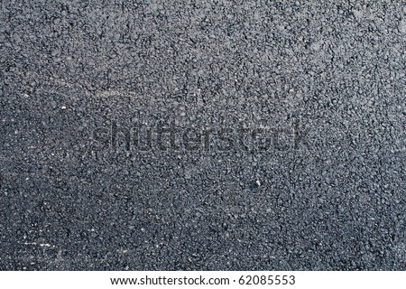 Top close-up horizontal view of new asphalt road